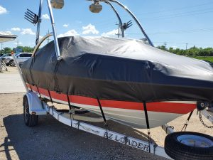 Black travel boat cover with high tower